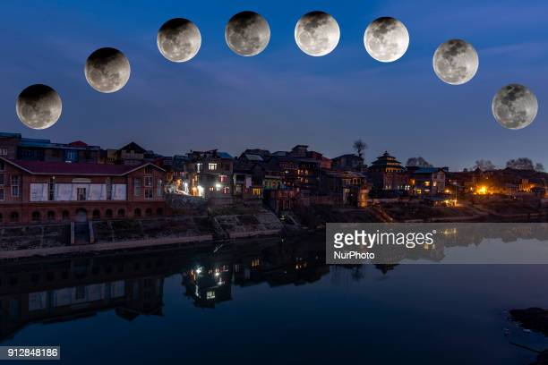 A photo composite of a partial lunar eclipse over the residential houses of river Jehlum on January 31 2018 in Srinagar the summer capital of Indian...