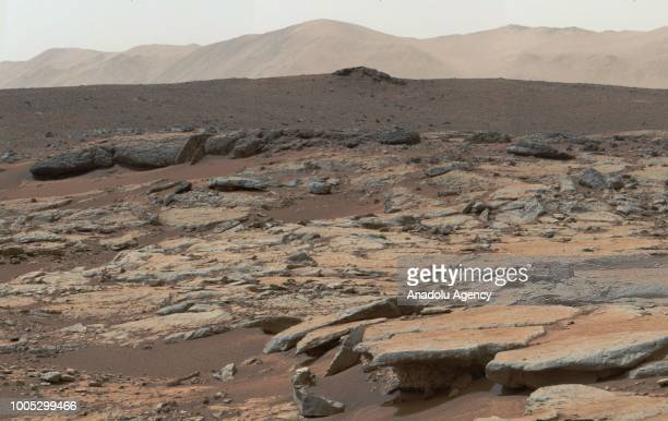 A photo covered by NASA's Curiosity Mars rover shows series of sedimentary deposits in the Glenelg area of Gale Crater from a perspective in...