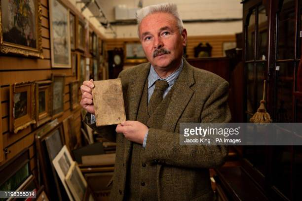 Militaria expert Adrian Stevenson of Hansons Auctioneers holds a battered diary written by a soldier during the Battle of the Somme in the First...