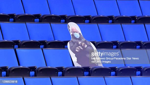 Photo cut out of Bernie Sanders from the Presidential Inauguration during a NCAA basketball game between the UCLA Bruins and the Oregon State Beavers...