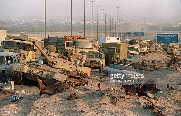 A photo dated 01 March 1991 showing a long line of vehicles including an Iraqi Russian built tank standing abandoned by fleeing Iraqi troops on the...