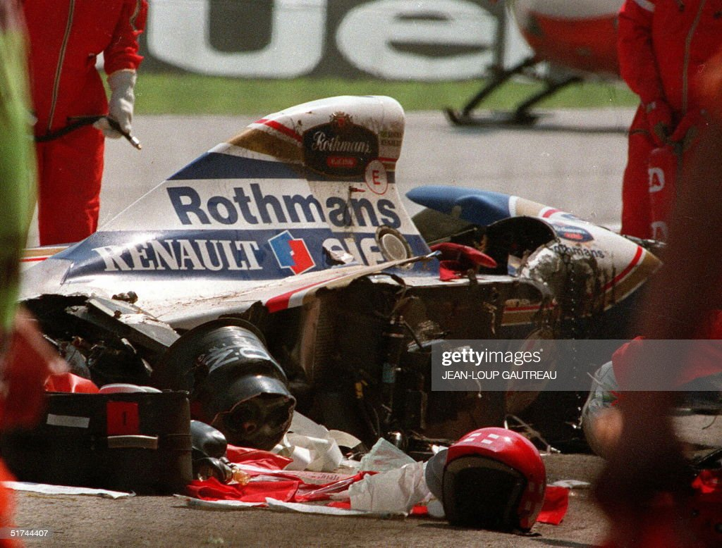 Photo dated 01MAY94 shows rescuers gathered around the remains of the Williams racing car after Brazilian Ayrton Senna's fatal crash at the San Marino Grand Prix. A nine-month trial into the death ended 16 December in Italy, in which team owner Frank Williams and two other team members, together with three race officials were charged with manslaughter.