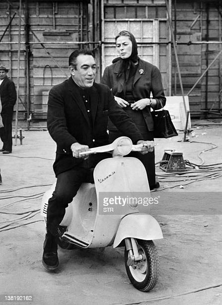 A photo dated 03 November 1963 shows US actor Anthony Quinn on a scooter waiting for his companion Swedish actress Ingrid Bergman to return to their...