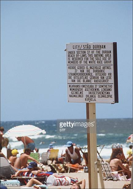 A photo dated 05 January 1987 of a notice board with the rules under which blacks were barred from swimming at the Whites Only section at a beach in...