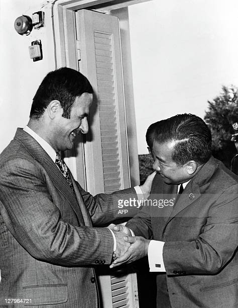 Photo dated 09 September 1973 of Syrian President Hafez alAssad welcoming Prince Norodom Sihanouk in Damascus AFP PHOTO