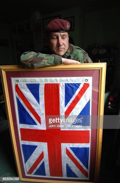 PA photo dated of Falklands War veteran Dave Brown who served with 2 Para in the Falklands with a Union flag he has had signed by numerous Falklands...