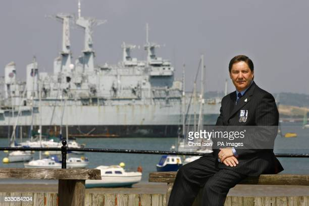 PA photo dated of former Royal Navy engineer Derek 'Smokey' Cole in front of the retired HMS Intrepid in Portsmouth Harbour Mr Cole served aboard the...