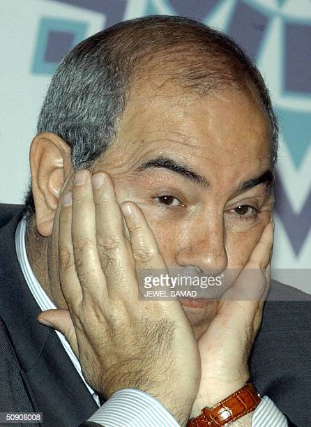 Photo dated 15 October 2003 of Iraqi Governing Council member Iyad Allawi at a press conference at the convention center in Malaysia's administrative...