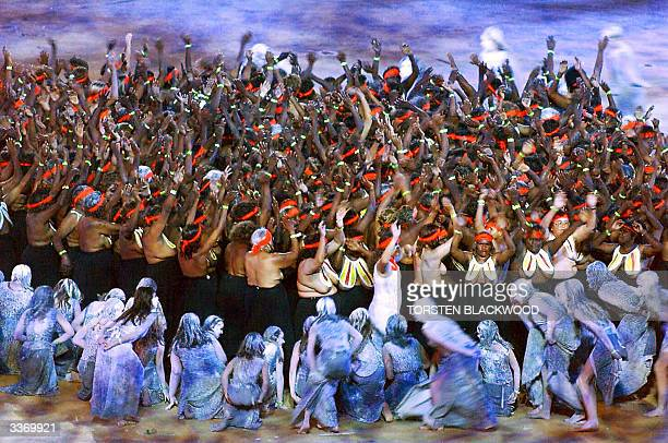 Photo dated 15 September 2000 of Aborigines performing a traditional dance during the Opening Ceremony of the Sydney Olympic Games Australian Prime...