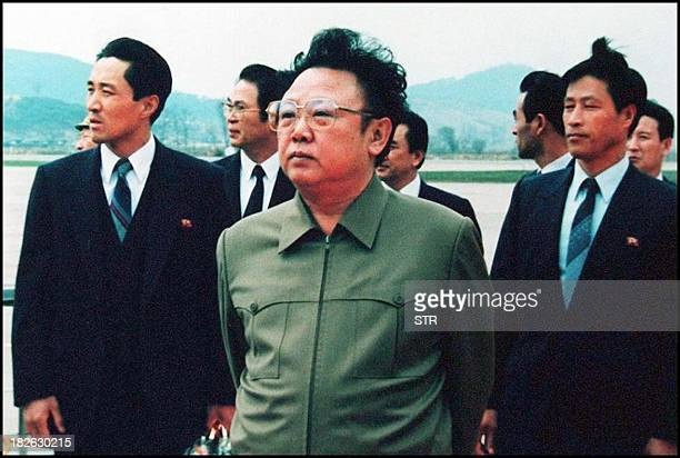 Photo dated 17 April 1992 shows North Korean leader Kim Jong-Il on the tarmac at Pyongyang Airport following a visit by then Chinese President Yang...