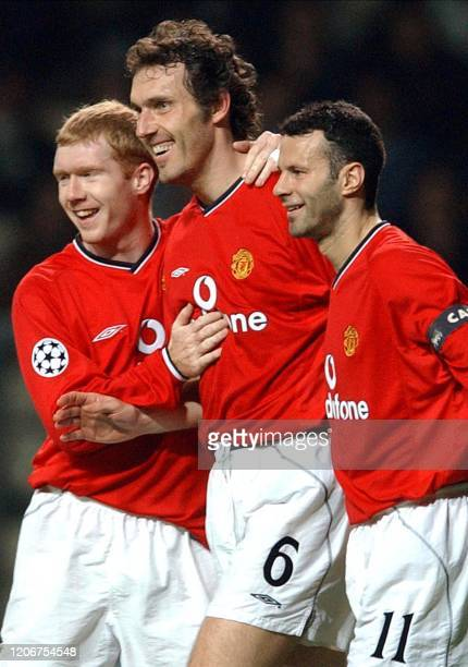 - Photo dated 19 March 2002 in Oporto shows Manchester United's French defender Laurent Blanc congratulated by teammates British Paul Scholes and...