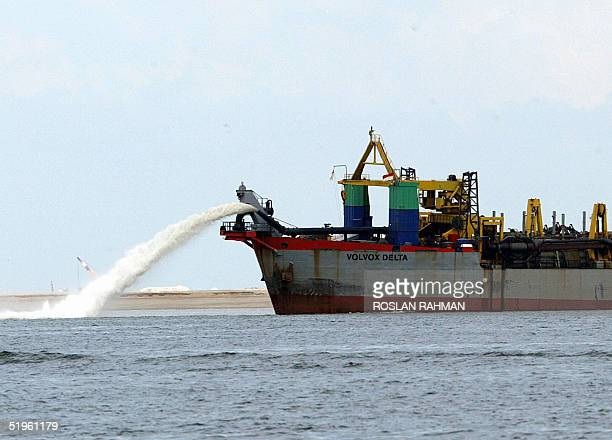 Photo dated 19 November 2003 of a dredger vessel spewing sands to fill the seabed for reclamation off western Singapore Singapore and Malaysia 14...
