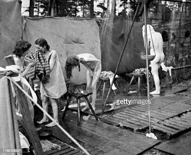 Photo dated 1944 of women prisoners washing outdoors at the Bergen-Belsen concentration camp. During its existence, approximately 50,000 persons died...