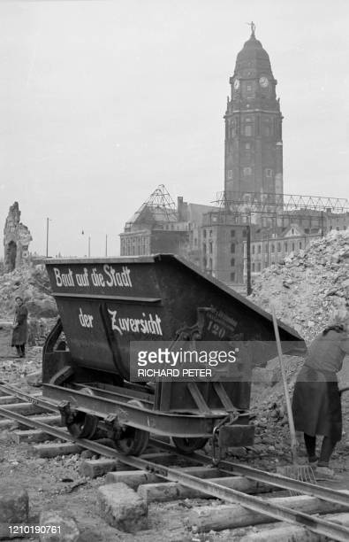 Photo dated 1945 showing residents and emergency personnel cleaning up rubble in front of the New City Hall building in the east German city of...