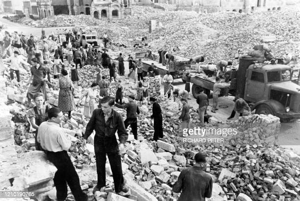 Photo dated 1945 showing residents and emergency personnel cleaning up the rubble in the east German city of Dresden following allied bombings 13...