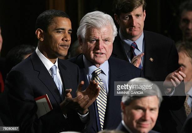 Photo dated 23 January 2007 shows US Democratic Senators Barack Obama of Illinois and Ted Kennedy of Massachusetts applauding during US President...