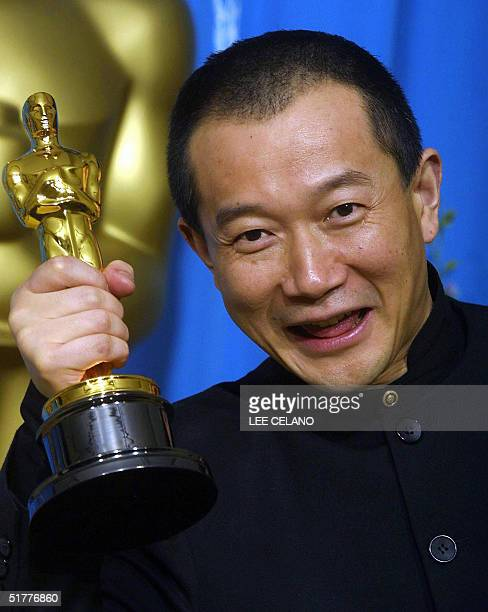 Photo dated 25 March 2001 shows composer Tan Dun holds his trophy for Best Original Score for his work on Crouching Tiger Hidden Dragon at the Shrine...