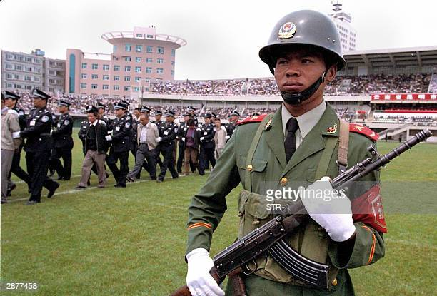 Photo dated 26 June 2001 shows Police parading various prisoners during an execution rally at a stadium in Kunming capital of China's southwestern...