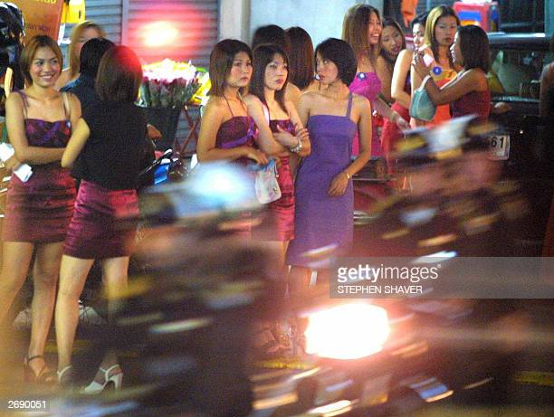 Photo dated 26 September 2001 shows young Thai prostitutes standing on the side of a street waiting for customers in Bangkok's downtown redlight...