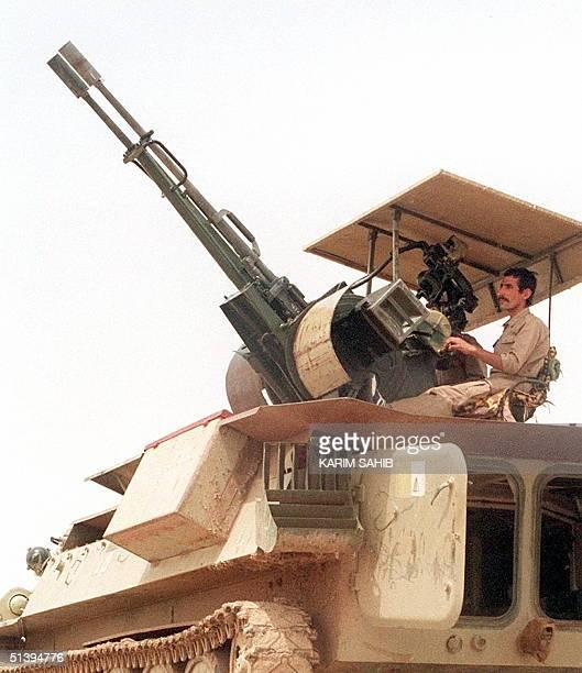 Photo dated 29 December 1998 shows an Iraqi soldiers manning an anti-aircraft multi-barrel gun in Baghdad. US and British warplanes struck Iraqi...