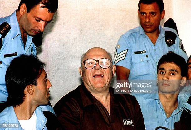 Photo dated 29 July 1993 shows convicted former Nazi concentration camp guard John Demjanjuk surrounded by security officers at the Israeli Supreme...