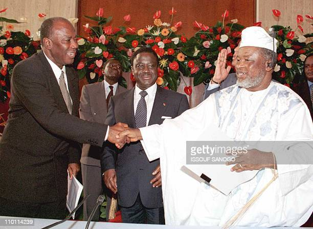 Photo dated 30 November 1996 shows Sierra Leone President Ahmad Tejan Kabbah and Foday Sankoh head of the rebel Revolutionary United Front shaking...