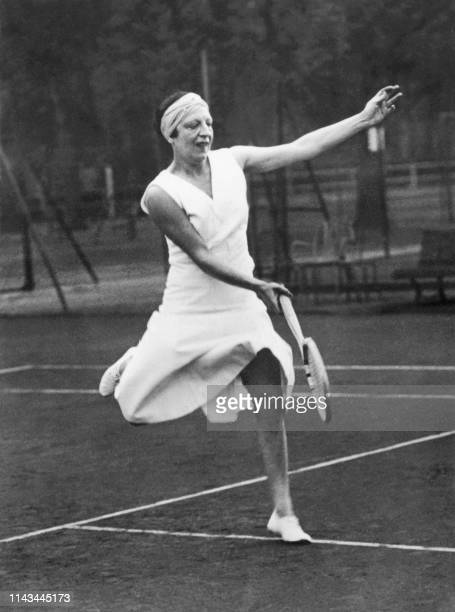 Photo dated from the '20s of French tennis player Suzanne Lenglen returning a forehand. Suzanne Langlen, who died in 1938 at the age of 39, remains...