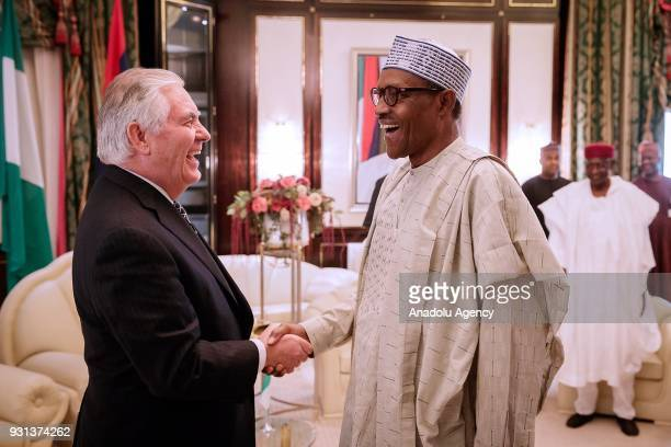 A photo dated March 12 2018 shows Rex Tillerson and Nigerian President Muhammadu Buhari during Tillerson's visit to Abuja Nigeria President Donald...