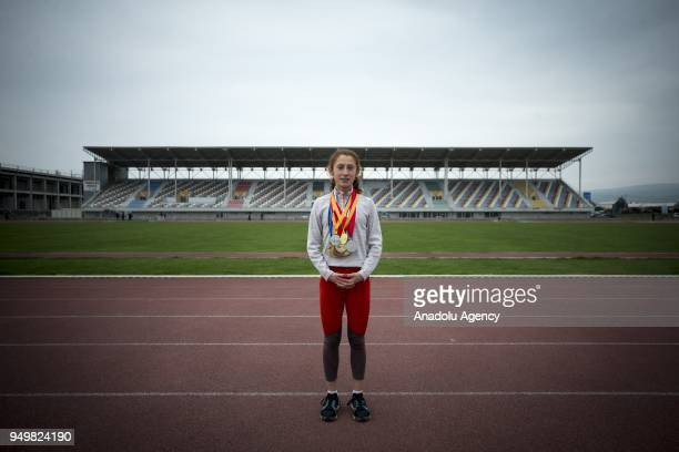 A photo dated March 29 2018 shows 14yearold Muhsine Gezer who had won the first prize of the IAAF World Indoor Championships 2018 first prize of...