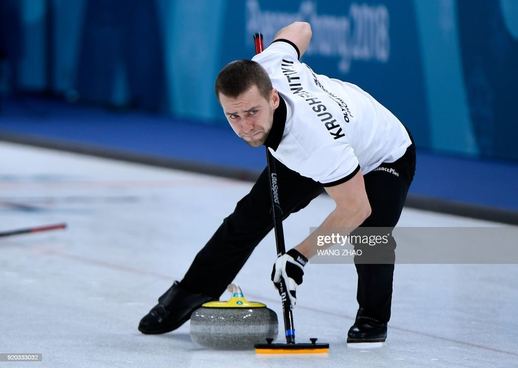 Photo dated on February 8, 2018 shows Russia's Aleksandr Krushelnitckii brushes the ice surface during the curling mixed doubles round robin session between the US and the Olympic Athletes from Russia during the Pyeongchang 2018 Winter Olympic Games at the Gangneung Curling Centre in Gangneung. The Court of Arbitration for Sport said it had opened an anti-doping case against Russian curler Alexander Krushelnitsky on February 19, 2018. / AFP PHOTO / WANG Zhao