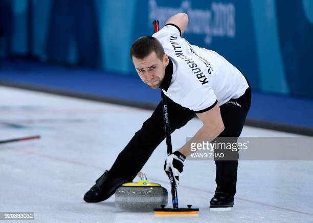 Photo dated on February 8 2018 shows Russia's Aleksandr Krushelnitckii brushes the ice surface during the curling mixed doubles round robin session...
