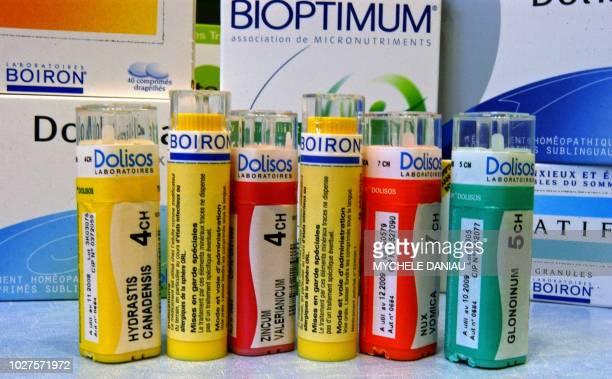. Photo de boîtes de médicaments homéopathiques de marques Dolisos et Boiron réalisée le 22 février 2005 à Caen. Un an après l'absorption du groupe...