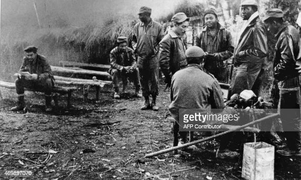 Photo depicts Cuban-Argentinian guerrilla Ernesto Che Guevara in a jungle camp of Congolese and Cuban soldiers involved in the guerilla movement in...