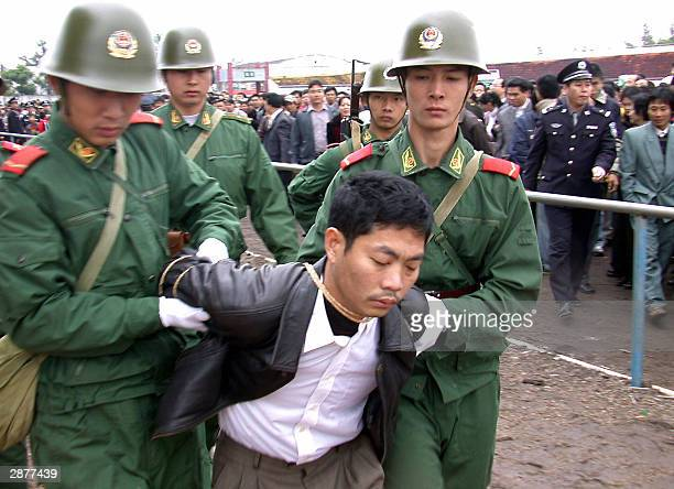 Photo dted 03 January 203 shows Huang Hu head of a failed Chinese kindergarten is taken for his execution at a public rally in Zhanjiang in China's...