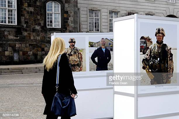 Photo ehibition by danish photographer Niels Peter Riisbro danish soldier in unform and in private dress at Christiansborg Castle today on saturday...