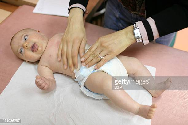 Photo Essay From An Infantile Protection Center 3 Month Old Baby Girl Palpation Of The Abdomen