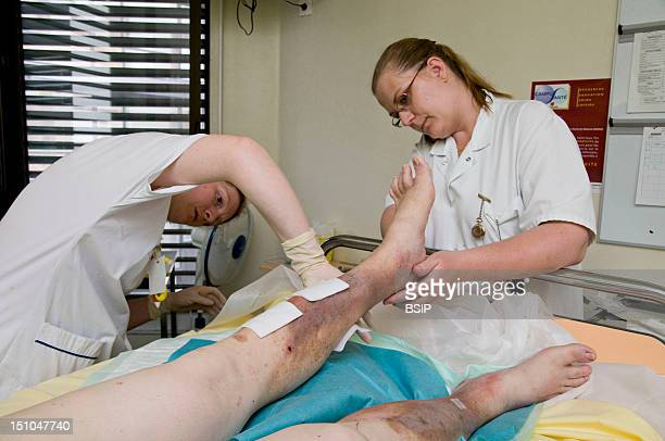 Photo Essay In The Department Of Diabetology At Saint Louis Hospital Paris France Cleaning Of Ulcer Small Wounds On The Legs Before Placing Tulle...