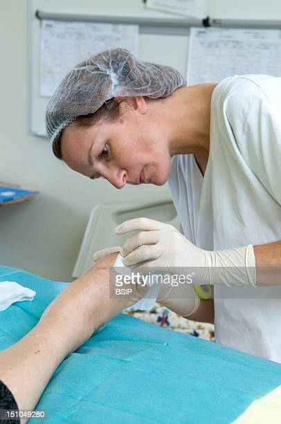 Photo Essay In The Department Of Diabetology At Saint Louis Hospital, Paris, France. A Nurse Caring The Diabetic Foot Ulcer.