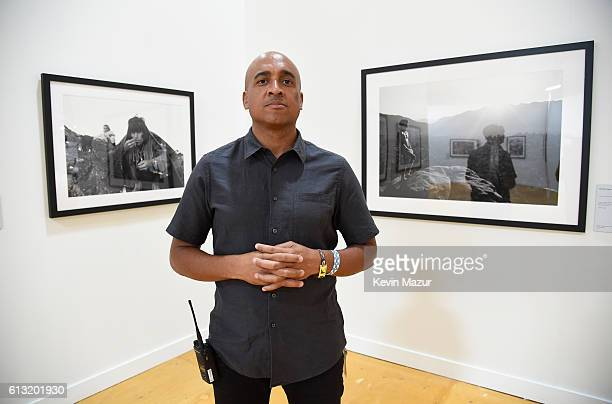 Photo exhibit curator Raymond Leon Roker is seen at the Desert Trip Photography Experience during Desert Trip at The Empire Polo Club on October 7...