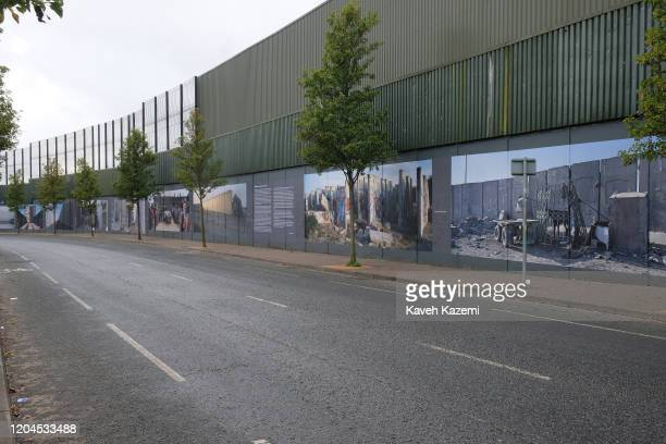 A photo exhibition of the existing walls around the world appears on the Republican side of the Cupar Way which runs between the peace line dividing...