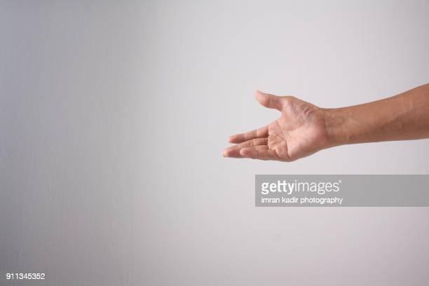 photo for body part hand - 手を伸ばす 男性 ストックフォトと画像