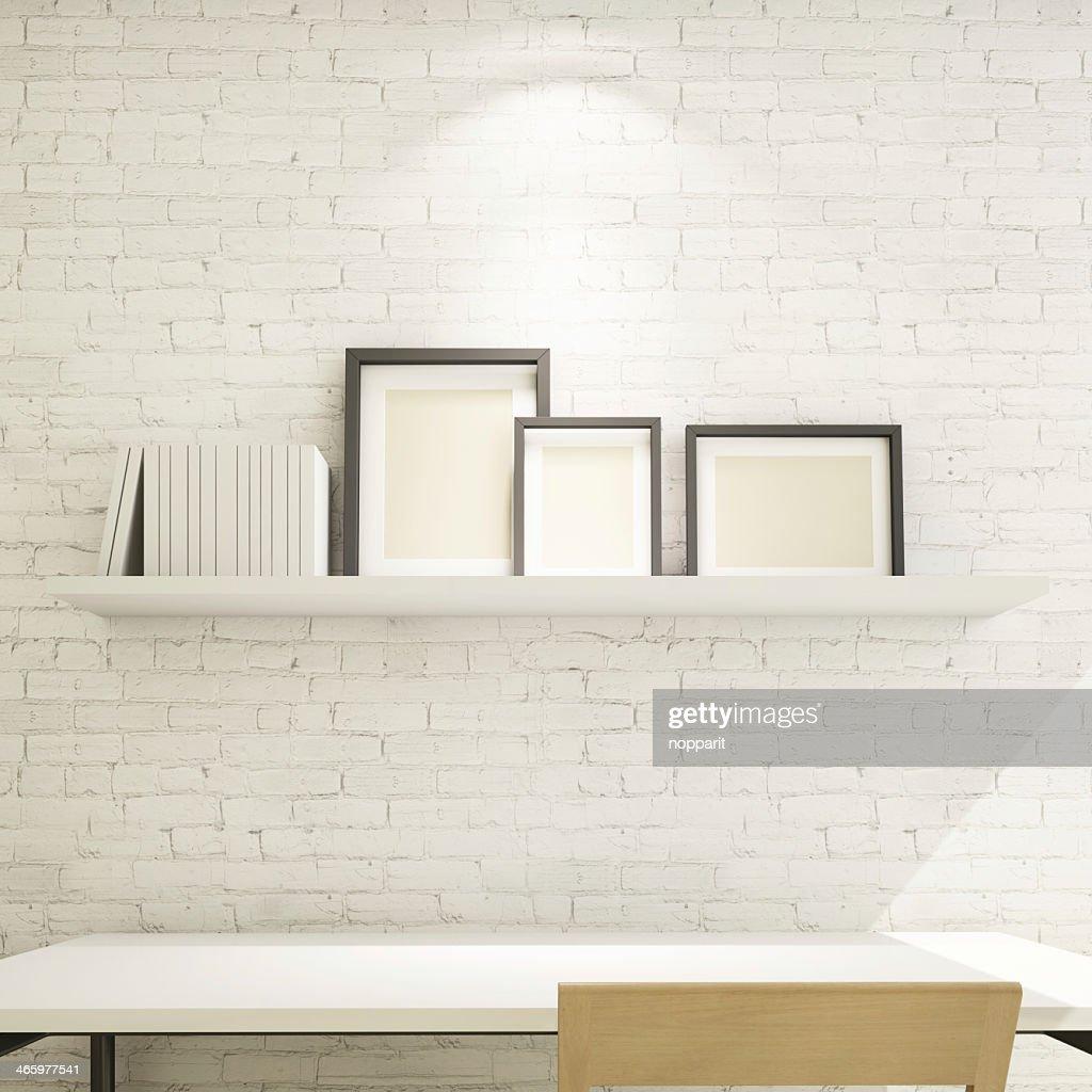 Etagere Sur Mur En Brique cadre photo sur une Étagère contre un mur de briques
