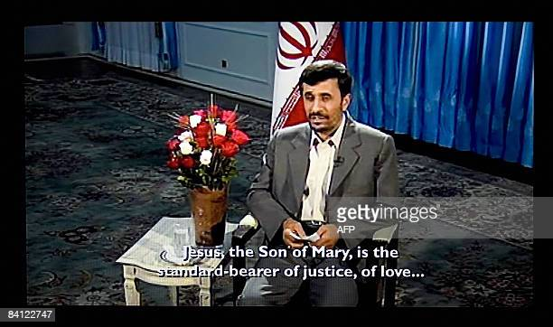 Photo grab shows a transmission of Iranian President Mahmoud Ahmadinejad delivering on Britain's Channel 4 an alternative Christmas message to...