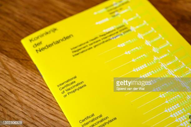 Photo illustration of a International certificate of Vaccination or Prophylaxis issued by the Kingdom of The Netherlands presented on a table on June...