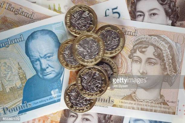 A photo illustration of the new British ten pound note featuring a portrait of Jane Austen pictured with the new polymer five pound note featuring...
