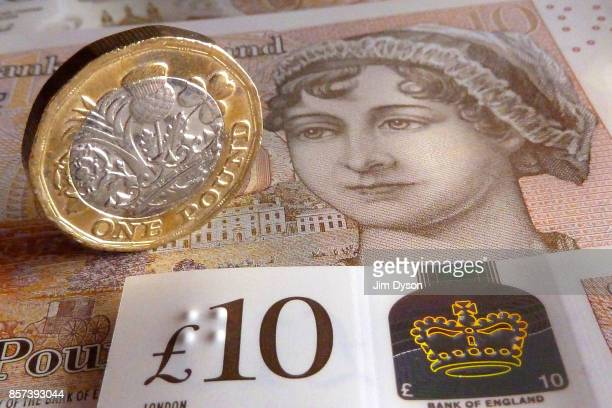 A photo illustration of the new British ten pound note featuring a portrait of Jane Austen with the new 12sided one pound coin on September 27 2017...