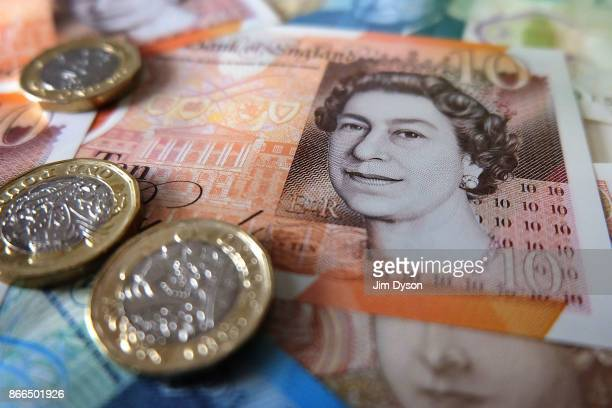 A photo illustration of the new polymer British ten pound note pictured with the new 12sided one pound coin on October 23 2017 in London England A...
