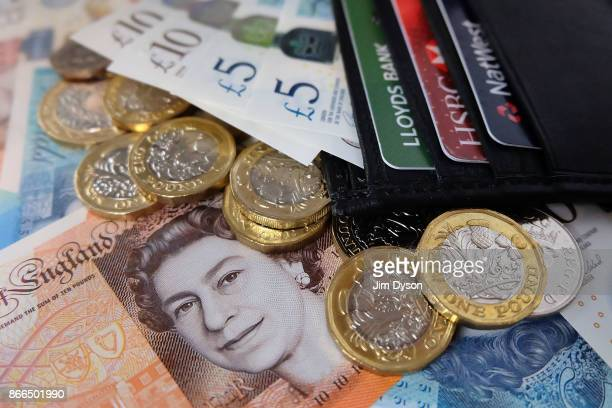A photo illustration of the new polymer British ten pound note pictured in a wallet with the new polymer five pound note and the new 12sided one...
