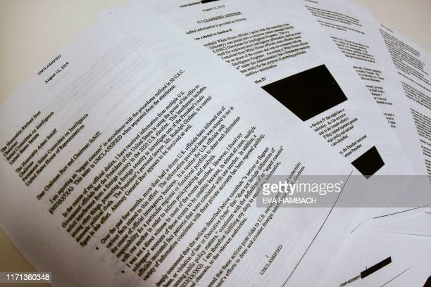 Photo illustration on September 26 2019 shows redacted pages of the whistleblower complaint referring to US President Donald Trump's call with his...