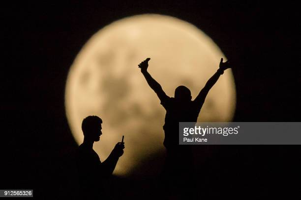 Photo Illustration showing people taking photos of the Super moon on January 31 2018 in Lancelin Australia Last seen from Australia in December 1983...